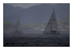 Yachting- The second start of the Bell Lawrie Scottish 2002 series at Inverkip racing to Tarbert Loch Fyne where racing continues over the weekend.<br /><br />Sigma 33s Miss Behavin' K4412 ans showtime K4267 struggle through a rain squall.<br /><br />Pics Marc Turner / PFM