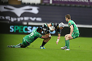 Hanno Dirksen of the Ospreys © is talked by Naulia Dawai of Connacht. Guinness Pro12 rugby match, Ospreys v Connacht rugby at the Liberty Stadium in Swansea, South Wales on Saturday 7th January 2017.<br /> pic by Andrew Orchard, Andrew Orchard sports photography.