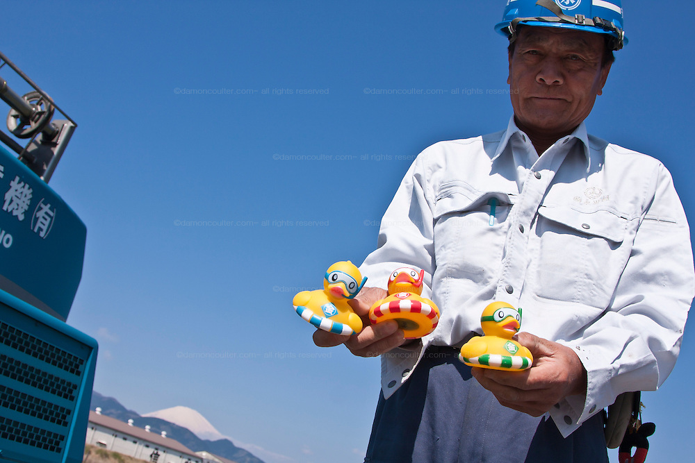 A festival official shows some of the fifteen thousand rubber ducks that will be emptied in to the Sakawa River during the Ashigara River festival, Kintaro duck-race in Matsuda, Kanagawa, Japan April 25th 2010