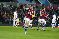 Rudy Gestede of Aston Villa ® celebrates after he scores his teams 1st goal to make it 1-1.  Barclays Premier league match, Aston Villa v Leicester city at Villa Park in Birmingham, The Midlands on Saturday 16th January 2016.<br /> pic by Andrew Orchard, Andrew Orchard sports photography.