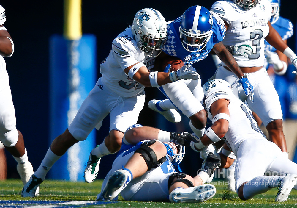 LEXINGTON, KY - SEPTEMBER 30: Garrett Johnson #9 of the Kentucky Wildcat runs the ball as Juan Giraldo #32 of the Eastern Michigan Eagles makes the tackle at Commonwealth Stadium on September 30, 2017 in Lexington, Kentucky. (Photo by Michael Hickey/Getty Images) *** Local Caption *** Garrett Johnson; Juan Giraldo