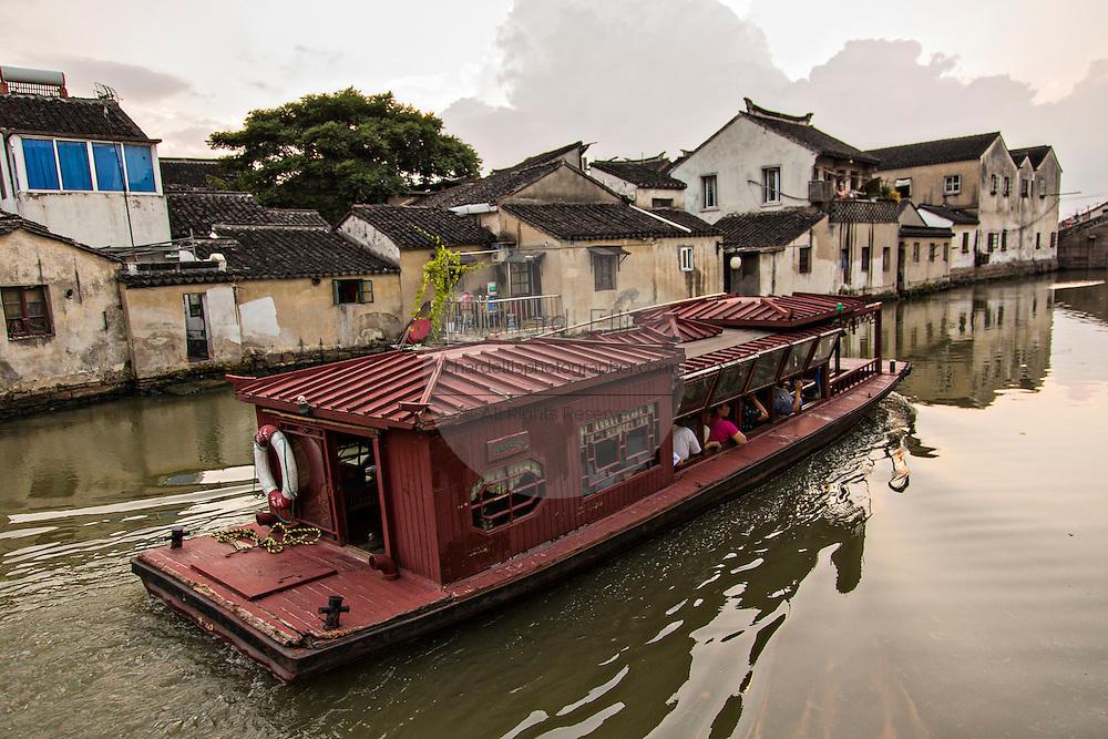 Boat travels along Shantang canal in Suzhou, China.