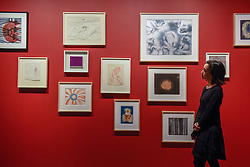 "© Licensed to London News Pictures. 17/02/2017. London, UK.   A staff member views works on paper by Louise Bourgeois and Yayoi Kusama, at a preview of ""Traumata: Bourgeois/Kusama"".  The joint exhibition is dedicated to the work of Louise Bourgeois and Yayoi Kusama, and takes place at Sotheby's S/2 Gallery 23 February to 13 April. Photo credit : Stephen Chung/LNP"