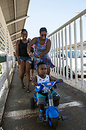 Foz do Iguazu, Brazil - March 28, 2019: A boy rides from Brazil to Paraguay on the Friendship Bridge, which connects the Brazilian city of Foz do Iguaçu and the Paraguayan city of Ciudad del Este. The white line marks the boundary.