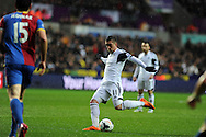 Swansea city's Pablo Hernandez shoots.  Barclays Premier league, Swansea city v Crystal Palace match at the Liberty Stadium in Swansea, South Wales on Sunday 2nd March 2014.<br /> pic by Andrew Orchard, Andrew Orchard sports photography.