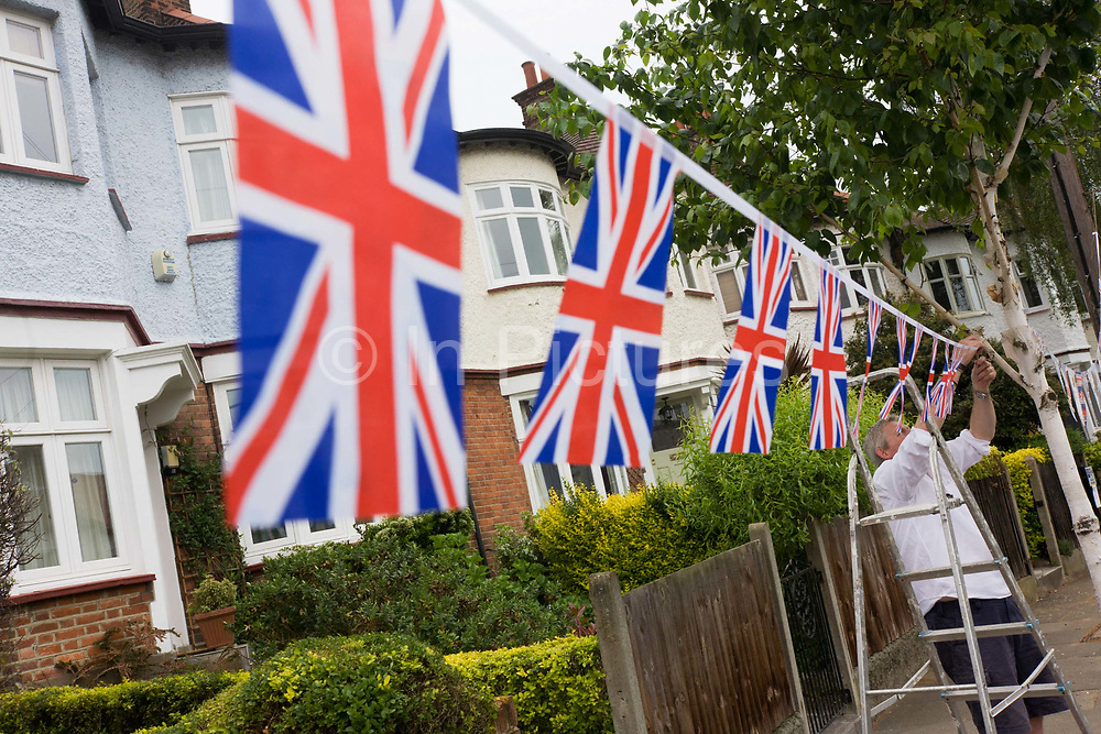 Neighbours and friends in Carver Road, Herne Hill south London, celebrate the royal wedding of Prince William and Kate Middleton (now called the Duke and Duchess of Cambridge). Across the UK, 5,500 formal road closures (825 in London) were arranged with local authorities and residents held traffic-free events, the like of which haven't been seen since the ill-fated wedding of Charles and Diana in 1981 – in the traditions of Victorian and end of war eras.