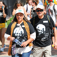 """A couple with Madiba T-shirts during the City of Cape Town hosted concert at the 45000 seater Cape Town Stadium called """"Nelson Mandela - A life Celebrated"""". Concert goers walked the Fan Walk, called the """"Walk of Remembrance"""" for today and placed flowers at a memorial wall outside the stadium. Nelson Mandela was the first democratically elected president of South Africa."""