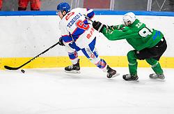 Zajc Miha of HK Olimpija vs Tedesco Daniel of Fassa  during Ice hockey match between HK SZ Olimpija and SHC Fassa Falcons in Round #20 of Alps Hockey League 2020/21, on February 16, 2021 in Hala Tivoli, Ljubljana, Slovenia. Photo by Vid Ponikvar / Sportida