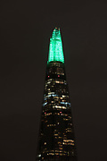 The top spire of the Shard is illuminated in green, on December 4th 2017 in London, United Kingdom, on the first evening of the Shards festive Christmas light show. Every evening, counting down to the start of 2018, the Shard will illuminate the London skyline from dusk till dawn, with Western Europe's highest light show each evening during December.