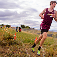 Rehoboth Lynx James Byker strides in for a first place finish in the district 1-3A meet Friday at Crownpoint High School.