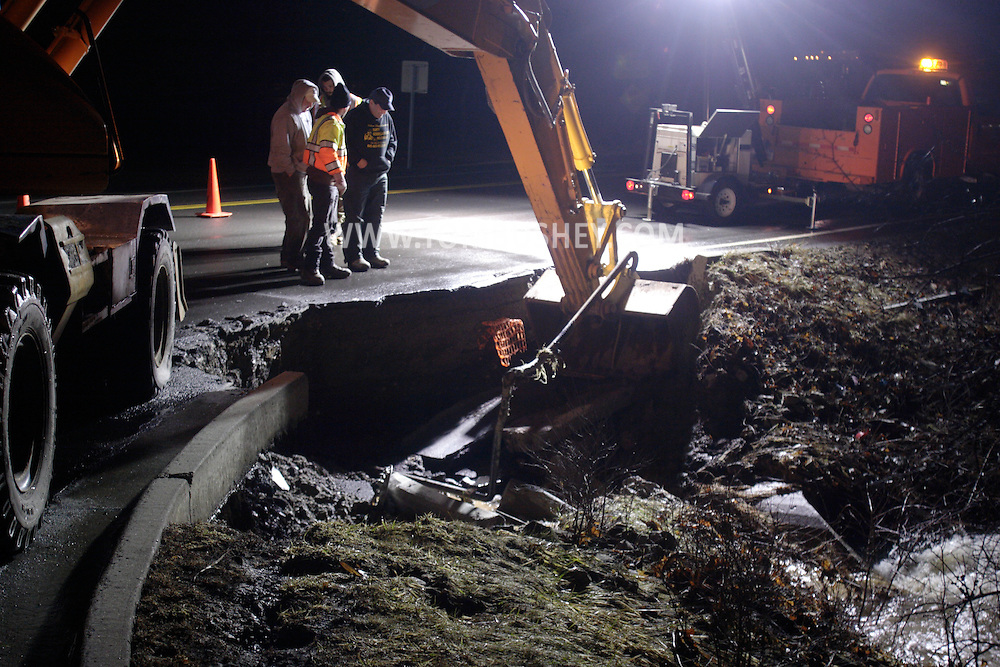 Town of Wallkill, NY - Highway department workers look at a section of roadway that was damaged by flooding after two days of heavy rain. March 8, 2008.