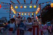 Women dance, Bon Odori during a summer matsuri or festival in a park in Tsuruma, Kanagawa, Japan. Sunday July 21st 2019
