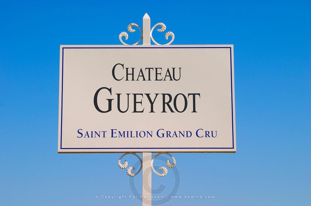 A white sign in the vineyard saying Chateau Gueyrot Saint Emilion Grand Cru Saint Emilion Bordeaux Gironde Aquitaine France