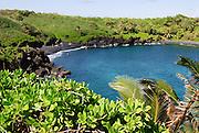 Honokalani Black Sand Beach at Wainapanapa State Park on Maui, Hawaii