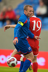 REYKJAVIK, ICELAND - Wednesday, May 28, 2008: Wales' Ched Evans flicks the ball past Iceland's Kristjan Orn Sigurdsson for the opening goal during the international friendly match at the Laugardalsvollur Stadium. (Photo by David Rawcliffe/Propaganda)