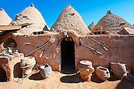 """Pictures of the beehive adobe buildings of Harran, south west Anatolia, Turkey.  Harran was a major ancient city in Upper Mesopotamia whose site is near the modern village of Altınbaşak, Turkey, 24 miles (44 kilometers) southeast of Şanlıurfa. The location is in a district of Şanlıurfa Province that is also named """"Harran"""". Harran is famous for its traditional 'beehive' adobe houses, constructed entirely without wood. The design of these makes them cool inside. 15 .<br /> <br /> If you prefer to buy from our ALAMY PHOTO LIBRARY  Collection visit : https://www.alamy.com/portfolio/paul-williams-funkystock/harran.html<br /> <br /> Visit our TURKEY PHOTO COLLECTIONS for more photos to download or buy as wall art prints https://funkystock.photoshelter.com/gallery-collection/3f-Pictures-of-Turkey-Turkey-Photos-Images-Fotos/C0000U.hJWkZxAbg ."""