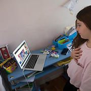 Brooklyn was required to watch the livestream of the Biden Inauguration as part of her virtual schoolwork on January 20, 2021. She stands for the inaugural's Pledge of Allegiance.