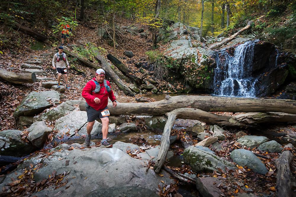 Michael Strzelecki of the Patapsco Trail Junkies leads a group across Casscade Falls.