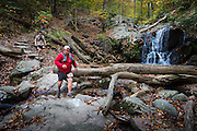 Michael Strzelecki of the Patapsco Trail Junkies leads a group across Casscade Falls.
