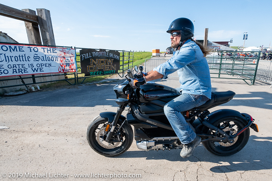 Jesse James Dupree, lead vocalist of Jackyl (and part of the Full Throttle Saloon and Jesse James Bourbon) took the Harley-Davidson Livewire out for a test ride from the Harley-Davidson garage at the Full Throttle Saloon during the Sturgis Black Hills Motorcycle Rally. Sturgis, SD, USA. Tuesday, August 6, 2019. Photography ©2019 Michael Lichter.