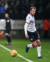 Bolton Wanderers' Christian Doidge keeps the ball in play<br /> <br /> Photographer Andrew Kearns/CameraSport<br /> <br /> The EFL Sky Bet Championship - Bolton Wanderers v Leeds United - Saturday 15th December 2018 - University of Bolton Stadium - Bolton<br /> <br /> World Copyright © 2018 CameraSport. All rights reserved. 43 Linden Ave. Countesthorpe. Leicester. England. LE8 5PG - Tel: +44 (0) 116 277 4147 - admin@camerasport.com - www.camerasport.com