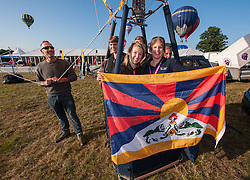 "© Licensed to London News Pictures. 08/08/2015. Bristol, UK. Day 3 of the Bristol International Balloon Fiesta 2015.  ""Team Tashi"" (Tashi means good fortune) in the Tibet balloon which is probably the largest Tibetan flag in the world.  The balloon has attracted some controversy as Chinese embassy officials have made several attempts to have the balloon grounded, by asking balloon festival organisers in Spain, France and the UK to cancel the balloon's entry to festivals.  The Bristol International Balloon Fiesta have refused to ban the Tibet balloon.  Photo credit : Simon Chapman/LNP"