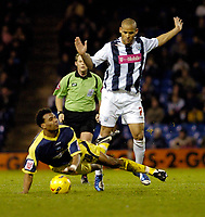 Photo: Leigh Quinnell.<br /> West Bromwich Albion v Derby County. Coca Cola Championship. 02/12/2006. West Broms Nigel Quashie fouls Derbys Giles Barnes to give away a free kick.