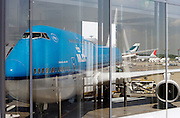 KLM Jumbo jet reflecting in window at the Narita international airport Tokyo Japan