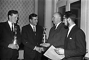 23/03/1963<br /> 03/23/1963<br /> 23 March 1963<br /> Gaelic Sports Journalists Association Presentation off Awards at the Anchor Hotel, Dublin. Image shows (l-r): Mr. Hugh Byrne, President of the G.A.A. presenting John Doyle of Tipperary the award for hurling, left is Kevin Coffey of Kerry (who accepted the football award for team mate Mick O'Connell) and right is film director Louis Marcus.