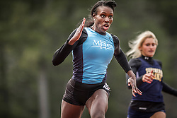 Camille Coklow, Mount Holyoke, wins 100 meters at Aloha Relays, Bowdoin College, Maine