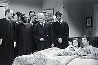1976, New York, New York, USA --- In a Saturday Night Live skit, Chevy Chase and Jane Curtin play a couple monitored in bed by the Supreme Court. The skit aired after the court upheld state laws banning sodomy. --- Image by © Owen Franken/CORBIS
