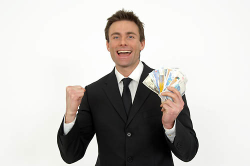 man punching the air with a fistful of bank notes, winner, Rob Wilkinson 07836546556<br />