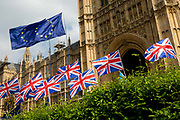 As MPs decide on how to progress with Brexit parliamentary procedure, EU and Union Jack flags fly outside the UK Parliament in Westminster, on 28th March 2019, in London, England.