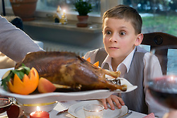 Boy looking at roasted duck