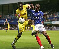 Photo: Lee Earle.<br /> Portsmouth v Leeds United. Carling Cup. 28/08/2007.Leeds Tomi Ameobi (L) battles with Sylvain Distin.