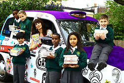 EDITORIAL USE ONLY<br /> Author Liz Pichon meets pupils at the launch of Scholastic&Otilde;s '100 Books for 100 Schools' giveaway with a Tom Gates themed taxi to celebrate the publication of her new book, Tom Gates: Family, Friends and Furry Creatures, at Drayton Green Primary School in Ealing, London.