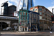 The Shipwrights Arms pub on Tooley street in London Bridge, with The Shard looming behind. Old architecture and a modern glass skyscraper in the same frame.
