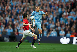 MANCHESTER, ENGLAND - Monday, April 30, 2012: Manchester City's Pablo Zabaleta in action against Manchester United's Park Ji-Sung during the Premiership match at the City of Manchester Stadium. (Pic by David Rawcliffe/Propaganda)