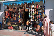 Shop selling leather goods such as bags, babouches slippers, Essaouira, Morocco