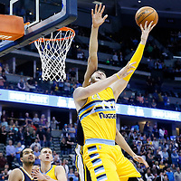10 April 2016: Denver Nuggets center Jusuf Nurkic (23) goes for the layup against Utah Jazz center Rudy Gobert (27) during the Utah Jazz 100-84 victory over the Denver Nuggets, at the Pepsi Center, Denver, Colorado, USA.