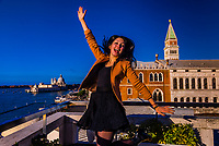 A Ukranian tourist jumps for joy atop the Hotel Danieli rooftop terrace, Venice, Italy.