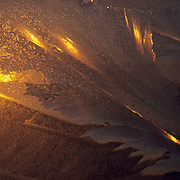 Abstracts, sunlight reflected off ice. Churchill, Manitoba. Canada.