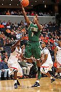 Nov. 12, 2010; Charlottesville, VA, USA;  William & Mary Tribe guard Kendrix Brown (1) shoots the ball in front of Virginia Cavaliers guard K.T. Harrell (24) and Virginia Cavaliers guard Jontel Evans (1) during the game at the John Paul Jones Arena.  Mandatory Credit: Andrew Shurtleff