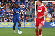 AFC Wimbledon defender Deji Oshilaja (4) dribbling during the EFL Sky Bet League 1 match between AFC Wimbledon and Scunthorpe United at the Cherry Red Records Stadium, Kingston, England on 15 September 2018.