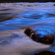 Herbert Rapid rushes headlong through the mighty Colorado River at the bottom of the Grand Canyon, Grand Canyon National Park, Arizona.