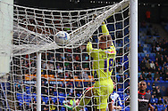 Carlisle United's goalkeeper Jordan Pickford watches the ball drop just over his bar. Skybet football league 1 match, Tranmere Rovers v Carlisle United at Prenton Park in Birkenhead, England on Saturday 29th March 2014. pic by Chris Stading, Andrew Orchard sports photography.