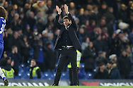 Antonio Conte, the Chelsea manager applauds the Chelsea fans after the match. Premier league match, Chelsea v Stoke city at Stamford Bridge in London on Saturday 31st December 2016.<br /> pic by John Patrick Fletcher, Andrew Orchard sports photography.