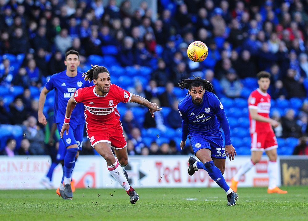 Middlesbrough's Ryan Shotton vies for possession with Cardiff City's Armand Traore<br /> <br /> Photographer Ashley Crowden/CameraSport<br /> <br /> The EFL Sky Bet Championship - Cardiff City v Middlesbrough - Saturday 17th February 2018 - Cardiff City Stadium - Cardiff<br /> <br /> World Copyright © 2018 CameraSport. All rights reserved. 43 Linden Ave. Countesthorpe. Leicester. England. LE8 5PG - Tel: +44 (0) 116 277 4147 - admin@camerasport.com - www.camerasport.com