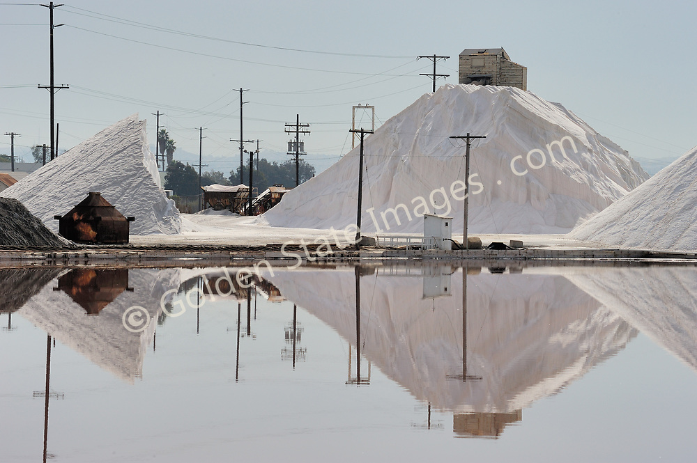 Since the late eighteen hundreds the South Bay Salt Works has been located at the very southern end of San Diego Bay. Its evaporation ponds cover almost 1200 acres and produce over 75000 tons of salt each year.<br /> <br /> The salt is extracted from seawater simply by filling large shallow ponds and allowing the sun to slowly evaporate the water.<br /> <br /> The Salt Works is the oldest continuously operated business in San Diego and also one of the oldest remaining wooden structures in the city.