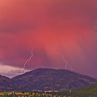An electric sunset shakes Bonner Mountain above the confluence of the Clark Fork and the Blackfoot Rivers.